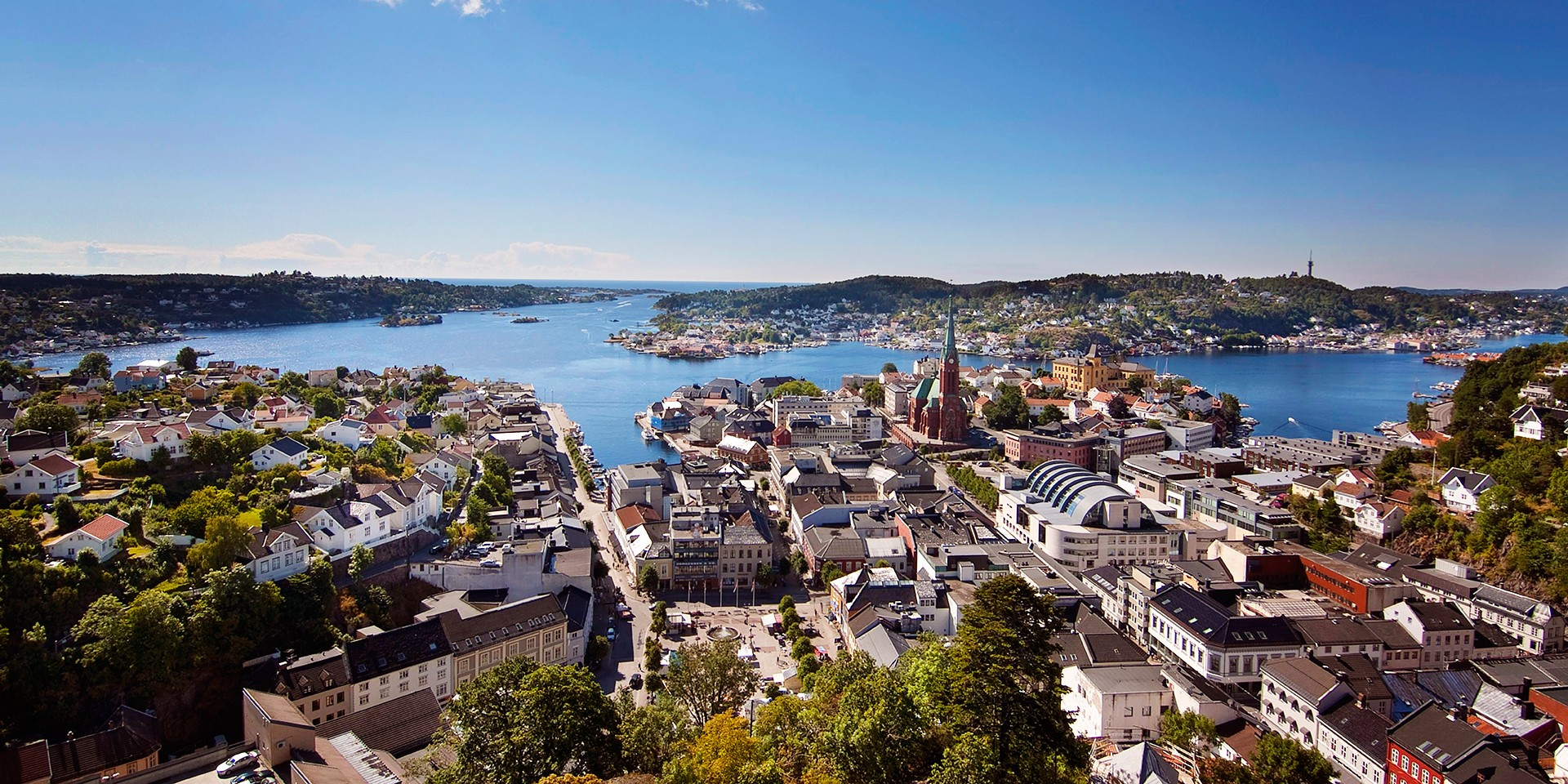 Overview picture of Arendal city with waterfront and surrounding islands