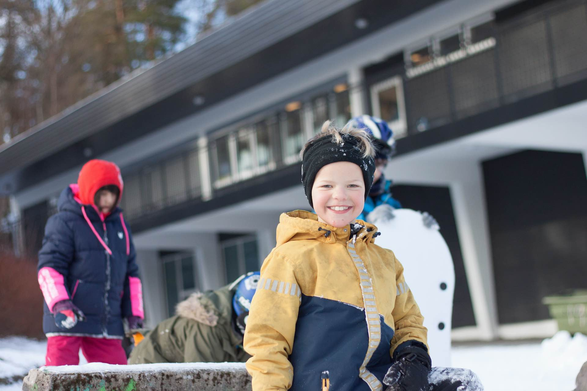A young boy playing in the snow at Arendal International School