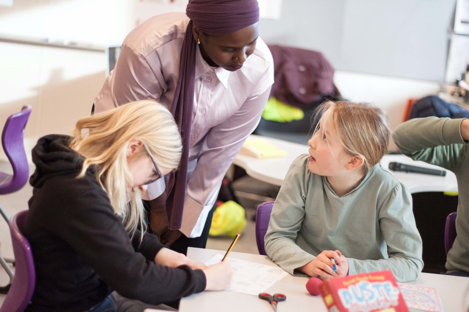Teachers in conversation with students at Arendal International School